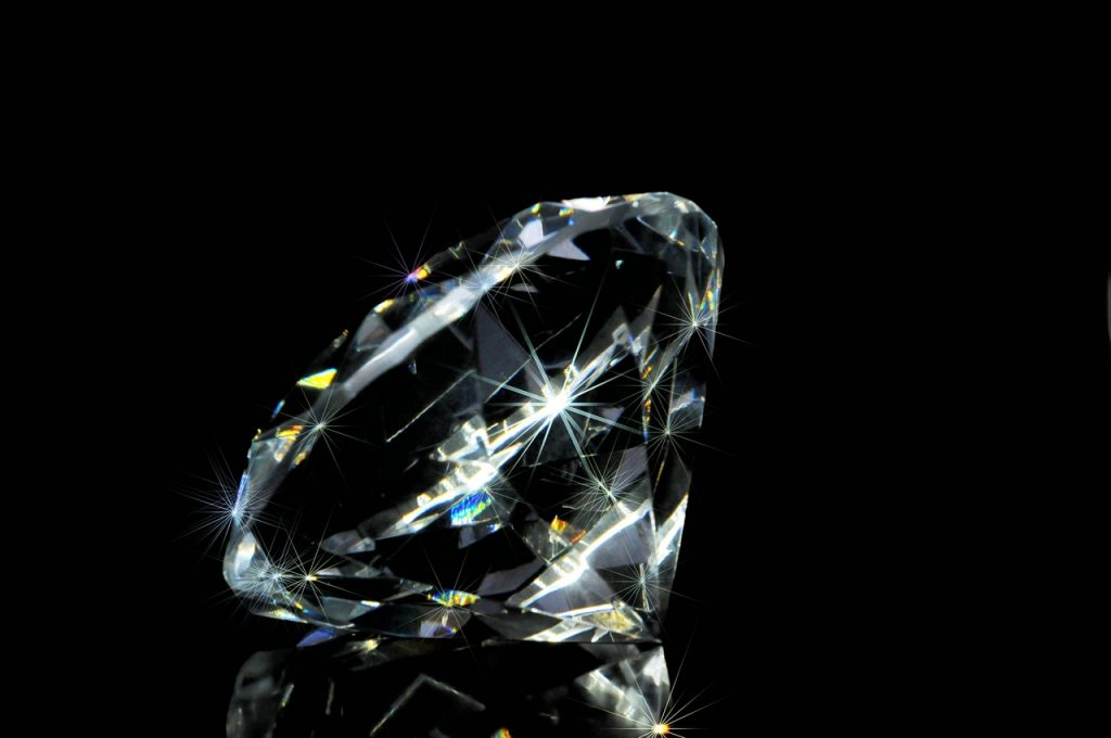 Clear diamond on black background