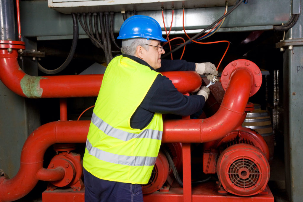 Technician Repairing Pumps